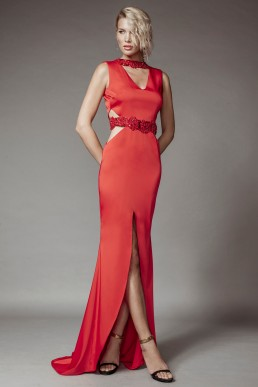 Red lycra dress, with waist cut outs, short train and beaded details